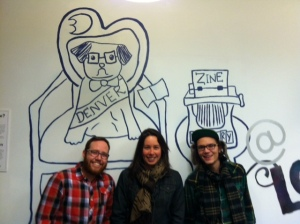 Zine librarians (Kelly, Heather and Cody) with the DZL mural - designed by Anna, mural painted by Tymla